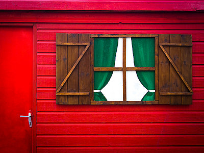 Wooden house painted red - p813m1000144 by B.Jaubert