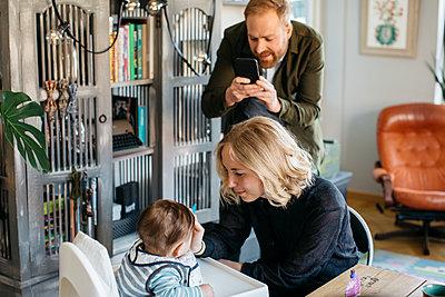 Parents with baby - p312m2139502 by Amanda Falkman