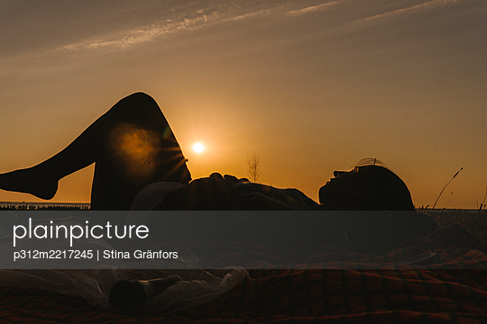 Silhouette of relaxing woman - p312m2217245 by Stina Gränfors