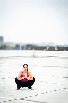 Yoga on a rooftop - p890m932930 by Mielek
