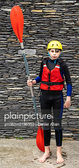 Boy with paddle for canoeing - p1082m2196350 by Daniel Allan