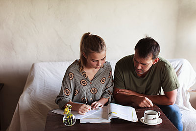 Father helping daughter with homework - p312m1533170 by Christina Strehlow