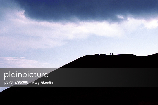 Silhouettes on hillside - p378m795388 by Mary Gaudin