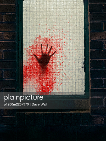 Blood-smeared hand on frosted glass window - p1280m2257979 by Dave Wall