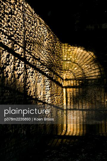 Sunlit old city wall - p378m2235893 by Koen Broos