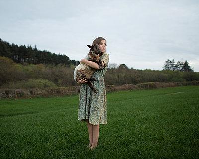 Girl Holding Lamb - p1503m2015928 by Deb Schwedhelm