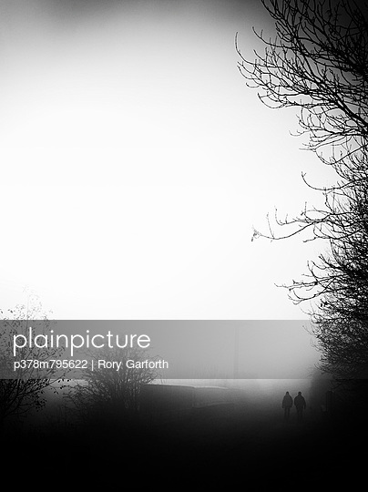 Walkers in heavy fog - p378m795622 by Rory Garforth