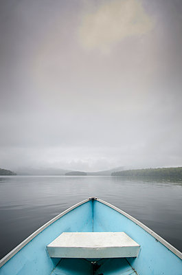 United States, New York, Lake Placid, View from rowboat on foggy lake - p1427m2271675 by Chris Hackett
