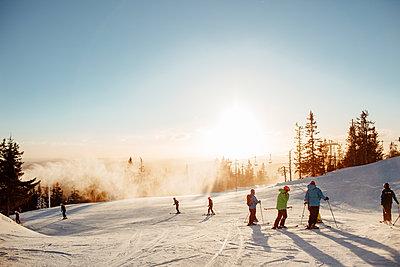 Skiers at sunset in Osterdalen, Norway - p352m1523659 by Benjamin Rudström
