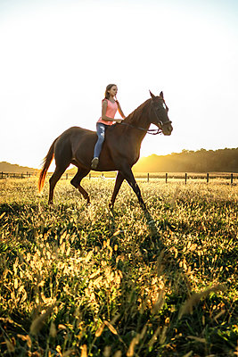 Teenage Girl riding Horse - p1019m1487235 by Stephen Carroll