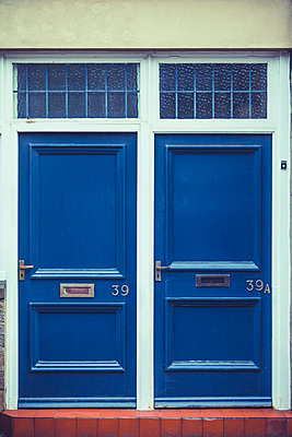 Two identical front doors to flats or apartments in Consett, County Durham, UK  - p1302m2110512 by Richard Nixon