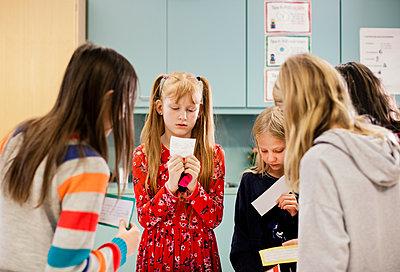 Girls in classroom - p312m2174775 by Scandinav