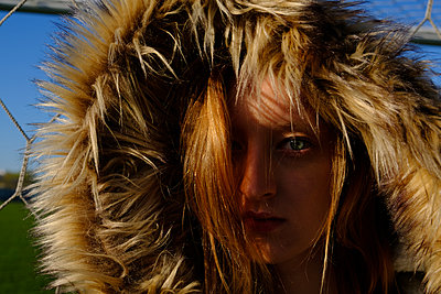 Portrait of a girl in jacket with fur on hood - p1363m1332314 by Valery Skurydin