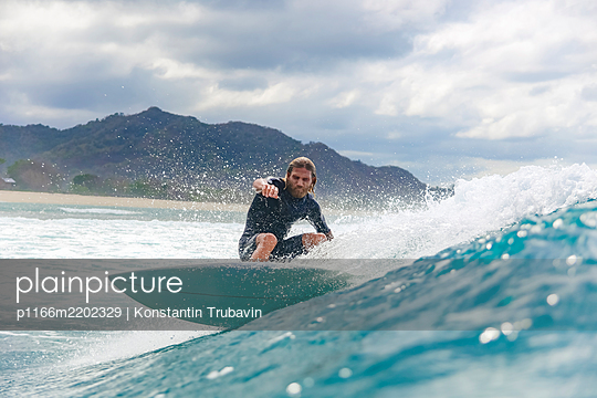 Surfer riding wave, Sumbawa, Indonesia - p1166m2202329 by Konstantin Trubavin