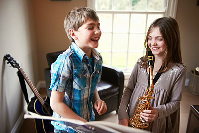 Children playing with saxophone - p429m800806f by Adie Bush