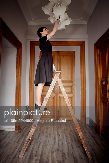 Changing a Light bulb  - p1105m2244900 by Virginie Plauchut