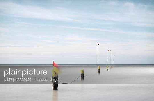 Germany, Flags in the North Sea - p1574m2285086 by manuela deigert