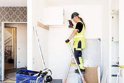Builder at work - p312m1187663 by Susanne Kronholm