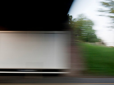 Billboard through train window - p388m702044 by Weather photography