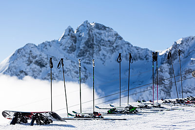 Rows of Ski and Ski Poles. Piz Julier Mountain,  St Moritz, Switzerland - p669m1585515 by Lee Irvine