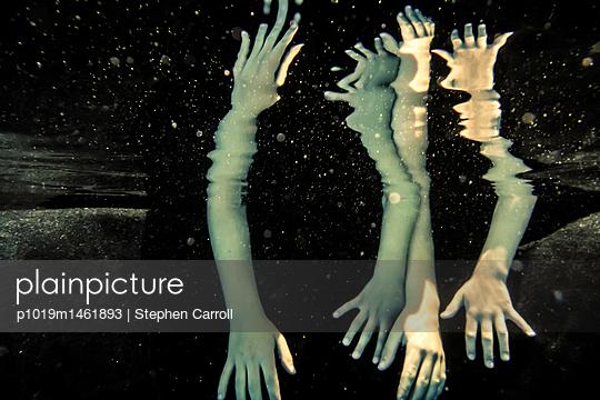 Hands underwater - p1019m1461893 by Stephen Carroll