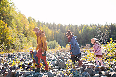 Family walking together - p312m2190363 by Matilda Holmqvist