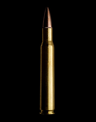 Single gun cartridge against black background - p5282806f by David Hamp