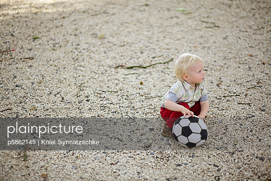 Little boy with football