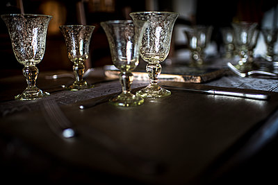 Old glasses on a table - p1007m1540389 by Tilby Vattard