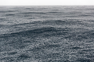 tropical storm and rain over the ocean - p1014m1443067 by Virginie Miramon