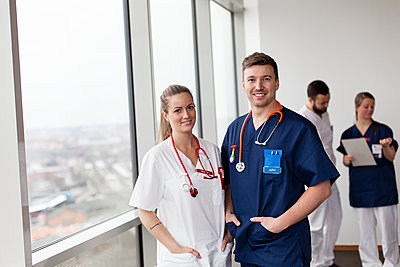 Young doctors looking at camera - p312m2174694 by Scandinav