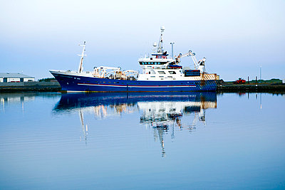 Fishing boat in harbour - p3883043 by Thomas Roussel