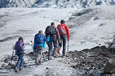 Family walking on glacier - p429m726996f by Henn Photography