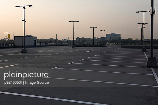 Empty parking lot - p9248353f by Image Source