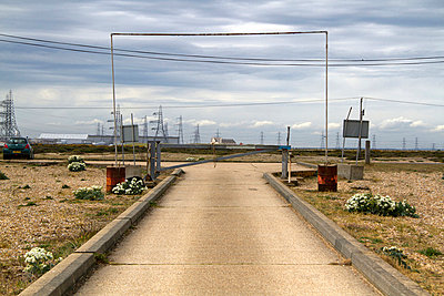 Road, pylons and power station in Dungeness, Kent, UK - p855m713459 by Robert Greshoff