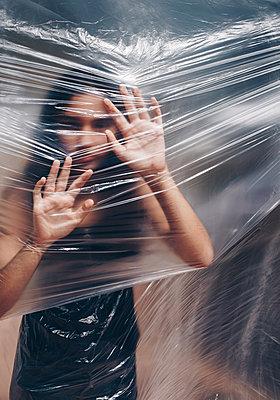 Girl under a plastic foil - p1623m2295002 by Donatella Loi