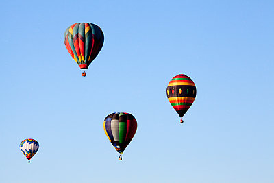 Hot air balloons floating in blue sky - p555m1415825 by Camilo Morales