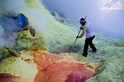 Sulphur miner at the Kawah Ijen Sulphur Mines in East Java - p934m1022326 by Dominic Blewett