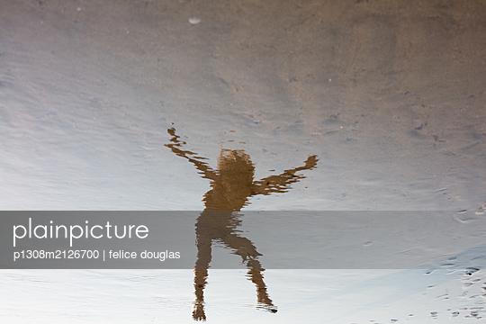 Child reflection beach - p1308m2126700 by felice douglas