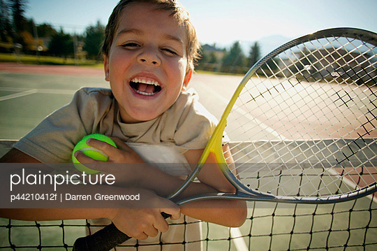 Boy With Tennis Racket