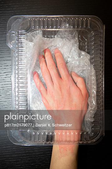 Hand in plastic package - p817m2179077 by Daniel K Schweitzer