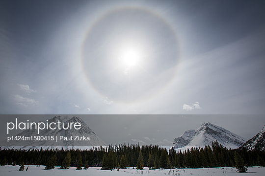 Sun halo over mountains - p1424m1500415 by Paul Zizka