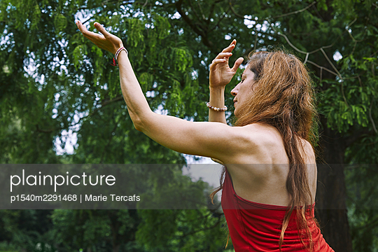 female shaman in nature - p1540m2291468 by Marie Tercafs