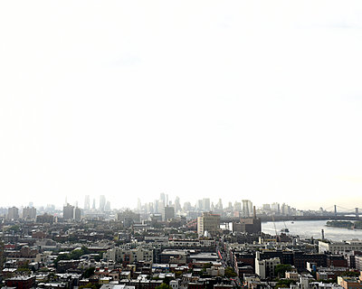 High angle view of cityscape against clear sky - p1166m1415106 by Cavan Images
