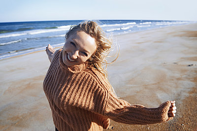 Happy woman having fun at the ocean beach - p1577m2150336 by zhenikeyev