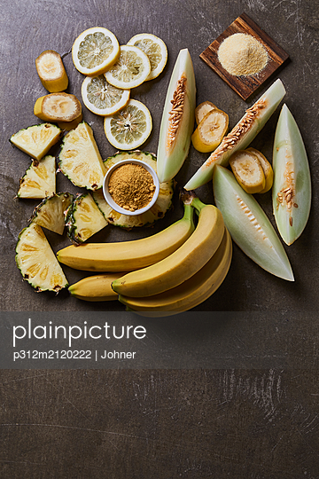 Yellow fruits and spices - p312m2120222 by Johner