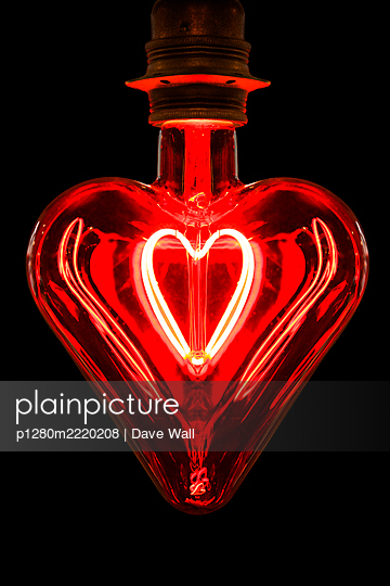 Heart-shaped light bulb, red light - p1280m2220208 by Dave Wall