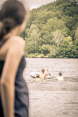 Playing in the lake - p1402m2125591 by Jerome Paressant