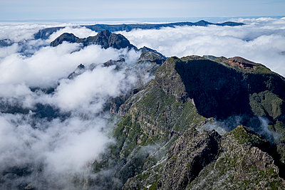 Portugal, Madeira, Clouds over mountains - p973m2172555 by Jennifer Rumbach