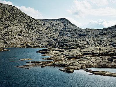 Rocky coast, Hardangerfjord, Norway - p1481m2203809 by Peo Olsson